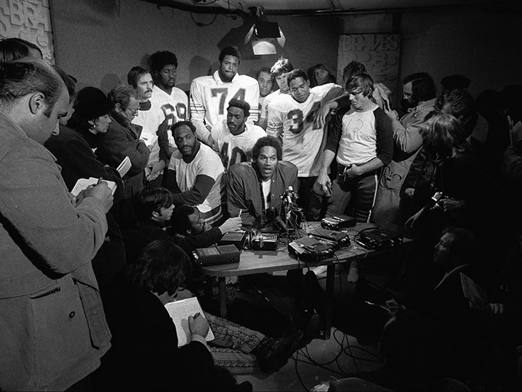 The Juice and the Electric Company: Buffalo Bills O.J. Simpson and teammates press conference in the boiler room of Shea Stadium in Queens, New York on December 16, 1973 OJSimpson.co