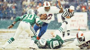 Buffalo Bills running back O.J. Simpson rushing in the snow against New York Jets on December 16, 1973 at Shea Stadium in Queens, New York. OJ Simpson Breaks NFL Single Season Rushing Record OJSimpson.co